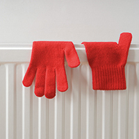 Red gloves on a radiator